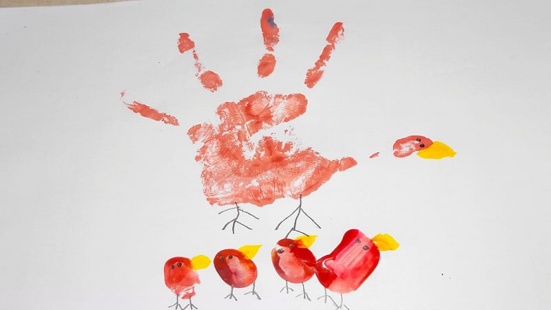Finger painting mother and baby
